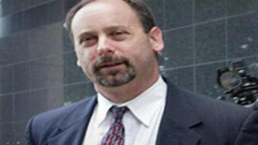 A former Security and Exchange Commission employee Spencer Barasch, a witness for prosecutors in the Arthur Andersen, trial leaves the federal courts building in Houston, Texas, after testifying 08 May 2002.