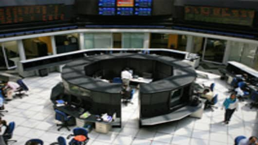 People work on the floor of the Mexican Stock Exchange, or Bolsa Mexicana de Valores (BMV), in Mexico City.