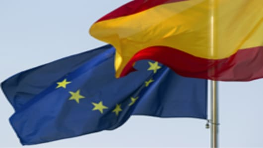 The European Union (EU) flag, left, flies alongside the Spanish national flag.