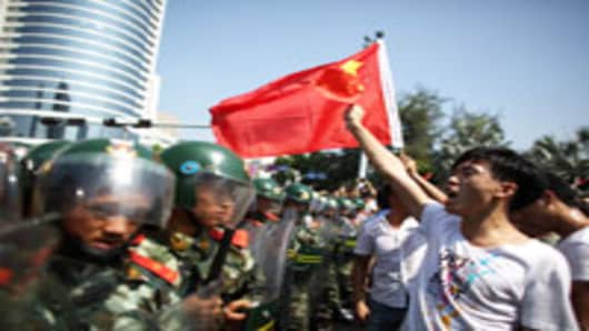 Anti-Japanese protesters are confronted by police as they demonstrate over the disputed Diaoyu Islands, on September 16, 2012 in Shenzhen, China.