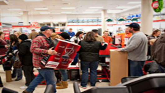 Black Friday shoppers wait to pay for items in a Sears store at Simon Property Group Inc.'s Great Lakes Mall in Mentor, Ohio.