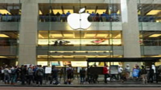 Customers queue up to purchase the iPhone 5 smartphone at Sydney's Apple flagship store