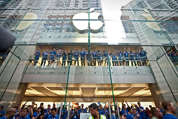 Apple employees cheer as the doors open at the company's store on George Street in Sydney, Australia, on Friday. Australia was one of the first countries in the world to offer the phone for sale. Gadget lovers in the country were among the first to get their hands on the new generation iPhone 5, with the lines snaking around Apple's flagship store, suggesting strong demand.