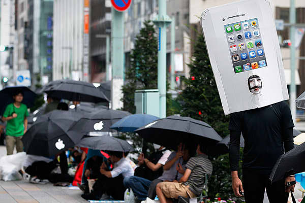 A customer in an iPhone costume stands in line to purchase an iPhone 5 outside the Apple Store Ginza in Tokyo, Japan, on September 21.