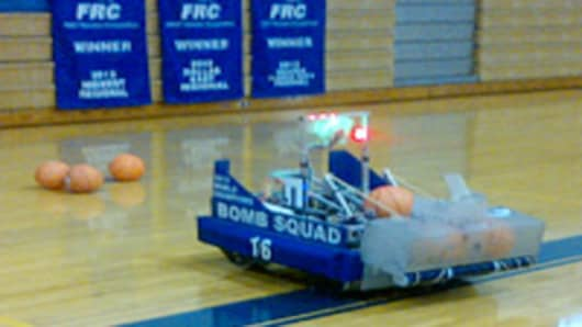 Basketball playing robot built by students.