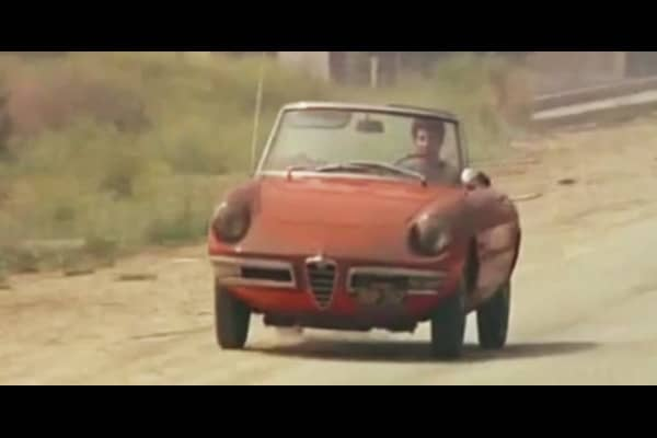 """Perhaps the most famous use of an Alfa Romeo in film is in the 1967 film The Graduate, starring Dustin Hoffman. The Graduate is easily the most popular film to feature an Alfa Romeo, ranking 21st all-time in box office gross when adjusted for inflation. In the film, Dustin Hoffman drives through California a series 1 """"Duetto"""" Spider, which was in production between 1966-67."""