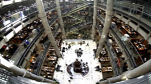 The interior of the Lloyd's of London building and the Lutine bell, center, is seen through a fish-eye lens in the City of London.