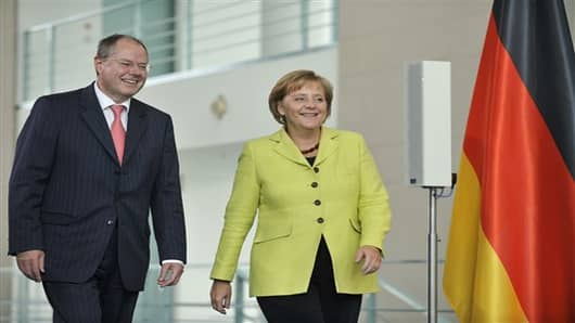 German Chancellor Angela Merkel, right, and then German Finance Minister Peer Steinbrueck, left.