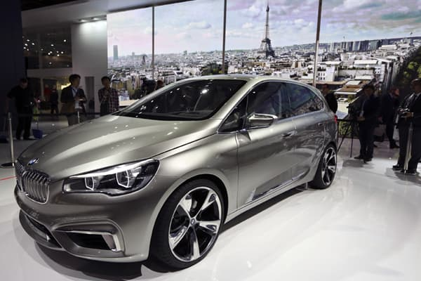 BMW unveiled its Concept Active Tourer at Paris, the German automaker's first-ever front-wheel drive car. The four door hatchback is a plug-in hybrid with a four wheel drive. It can be powered for up to twenty miles in electric only mode after a top-up from the mains.