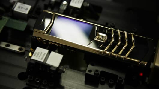 A Vertu yellow gold Signature mobile handset is seen during assembly at Nokia Oyj's Vertu luxury phone division in Church Crookham, U.K., on Monday, Sept. 12, 2011.