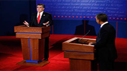 Republican presidential candidate, former Massachusetts Gov. Mitt Romney (L) speaks during the Presidential Debate as Democratic presidential candidate, U.S. President Barack Obama (R) looks on at the University of Denver.