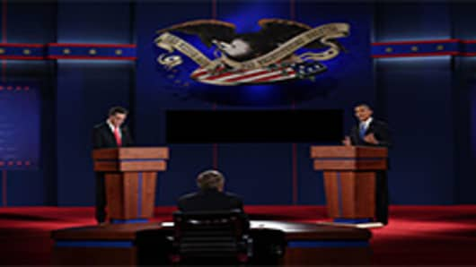 Democratic presidential candidate, U.S. President Barack Obama (R) speaks as Republican presidential candidate, former Massachusetts Gov. Mitt Romney listens during the Presidential Debate at the University of Denver.