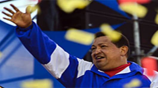 Venezuelan President Hugo Chavez waves to supporters during a campaign rally for his reelection in Valencia, Carabobo state, Venezuela.
