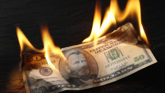 50 dollar bill on fire
