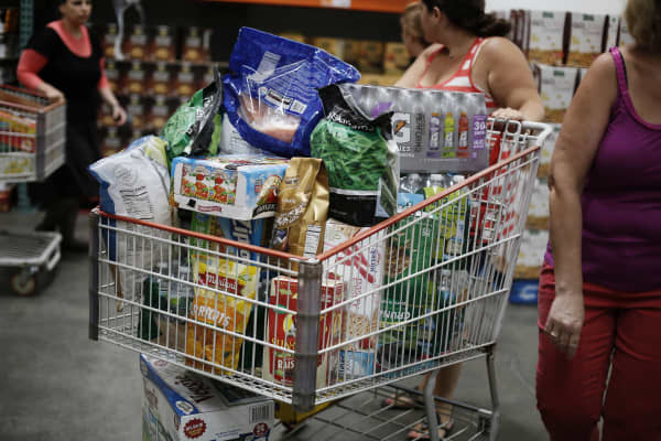 Shoppers fill their carts at a Costco Wholesale Corp. warehouse in Brooklyn, New York, U.S.