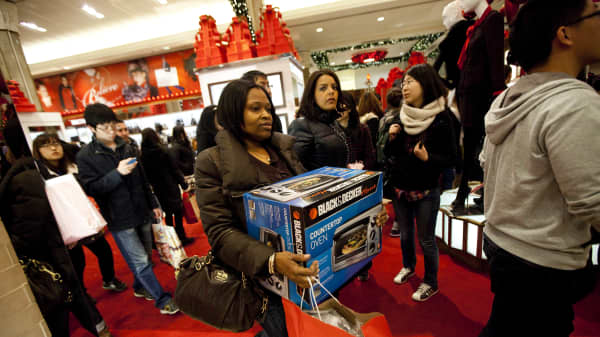 A bargain hunter carries a toaster oven at Macy's on 'Black Friday' in New York City.