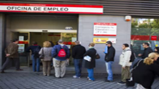 Jobseekers wait to enter an employment center after opening in Madrid, Spain.