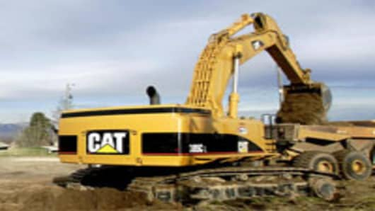 Caterpillar Earnings Beat, but It Cuts Full-Year Outlook