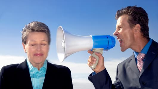 Boss yelling at employee through megaphone