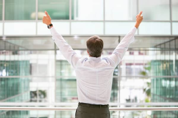 businessman with thumbs up in the air