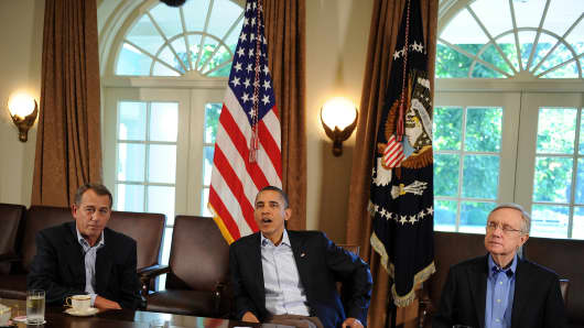 House Speaker John Boehner, President Obama and Sen. Harry Reid.