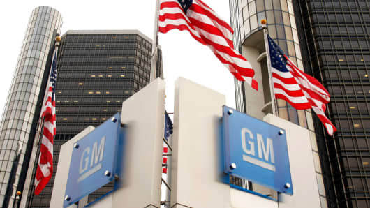 Signs stand in front of the General Motors world headquarters complex in Detroit, Michigan.