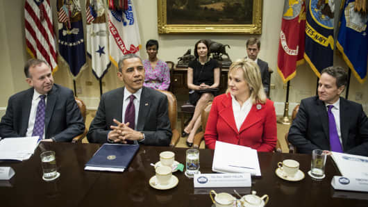 President Obama  and Treasury Secretary Timothy F. Geithner (R) meet Tuesday with Governors Jack Markell of Delaware (L) and Mary Fallin of Oklahoma.