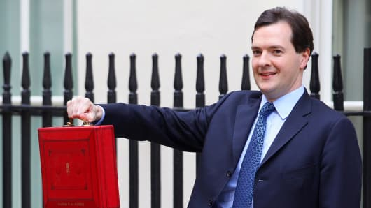 Chancellor of the Exchequer George Osborne poses for photographers outside 11 Downing Street.