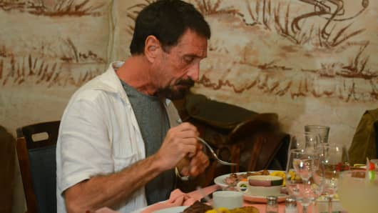 US anti-virus software pioneer John McAfee eats in a restaurant in Guatemala City.