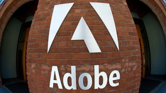 Adobe Systems Inc. signage is displayed outside of the company's office in San Francisco, California, U.S.