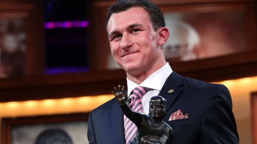 Johnny Manziel of the Texas A&M University Aggies after being named the 78th winner of the Heisman Memorial Trophy Award