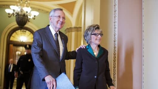 Senate Majority Leader Harry Reid, D-Nev., and Sen. Barbara Boxer, D-Calif., make their way to the senate luncheons in the Capitol.
