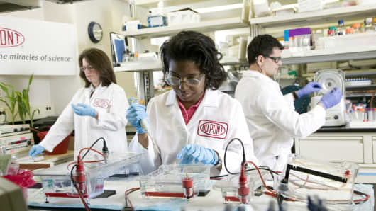 DuPont research scientists at work in a biobutanol molecular biology lab.