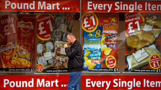 A member of the public walks past a pound shop