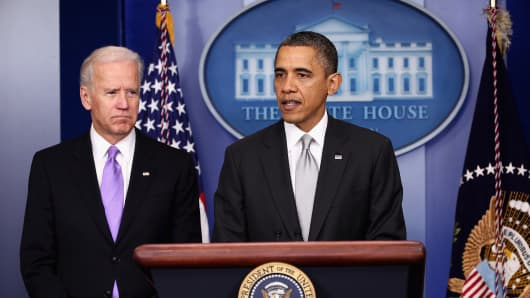 President Barack Obama announces the creation of an interagency task force for guns as as Vice President Joseph Biden listens on.
