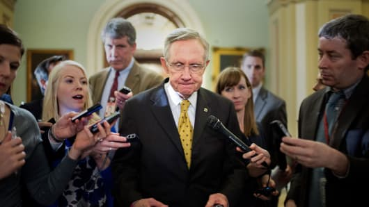 Senate Majority Leader Harry Reid, makes his way to a meeting of the Senate Democratic Conference as Congress continues a weekend session in the hopes averting the 'fiscal cliff'.