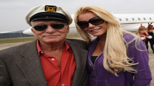 Playboy founder Hugh Hefner and his fiance Crystal Harris