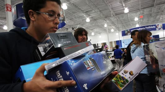 Shoppers move through a Best Buy store.