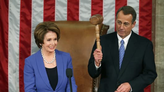 Nancy Pelosi stands with House Speaker John Boehner after presenting him with the gavel during the first session of the 113th Congress.
