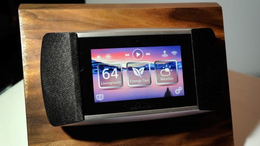 An Eversense electronic thermostat by Allure Energy. The electronic energy management system allows a user to control the a home environment using a smartphone.