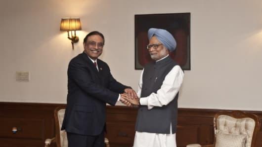 Indian Prime Minister Manmohan Singh shakes hands with Pakistan President Asif Ali Zardari.