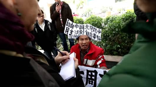 A supporter of Southern Weekly protests outside the newspaper's offices in Guangdong.