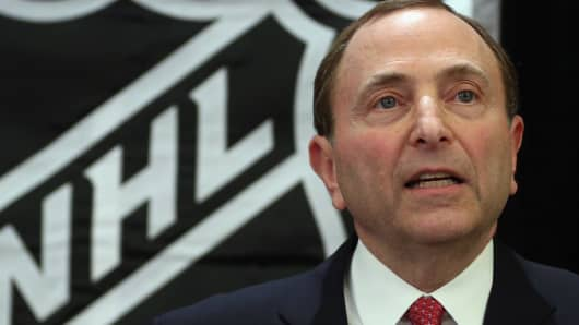 National Hockey League Commissioner Gary Bettman speaking at a press conference announcing the start of the NHL season.