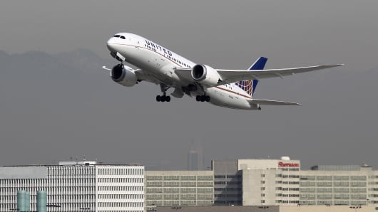 A Boeing 787 Dreamliner operated by United Airlines takes off at LAX