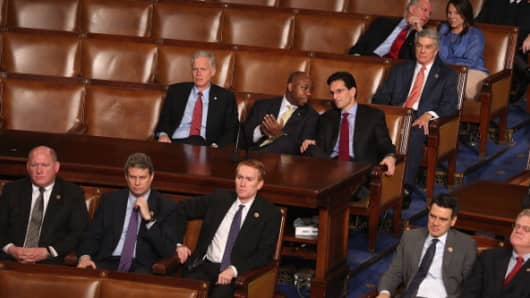 Republican members of Congress listen as the votes of the Electoral College are tallied in the House on Jan. 4, 2013.