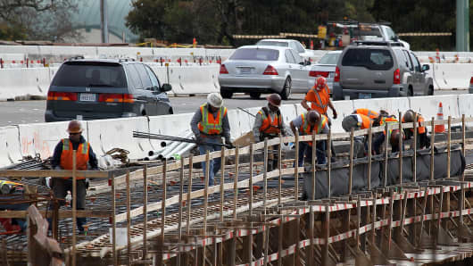 Construction crews work along Highway 101 in Novato, Calif.