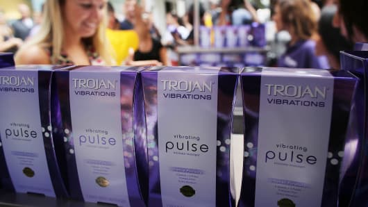 People receive a free vibrator sex toy which was being distributed by the Trojan condom company from their 'Pleasure Carts' on August 9, 2012 in New York City.