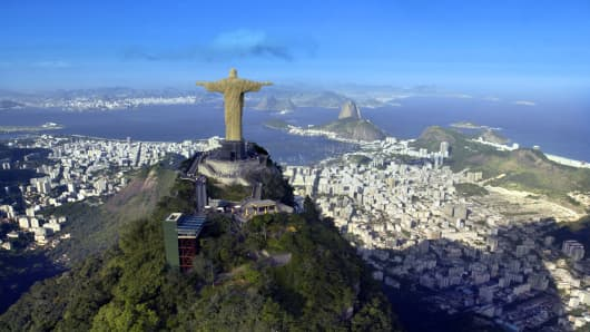 Aerial view of Christ the Redeemer Monument in Coreovado overlooking the city and Sugarloaf Mountain - Rio de Janeiro in Brazil.