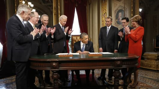President Barack Obama signing a proclamation to commemorate the inauguration directly after swearing-in ceremonies in the U.S Capitol on January 21, 2013 in Washington, DC. U.S.