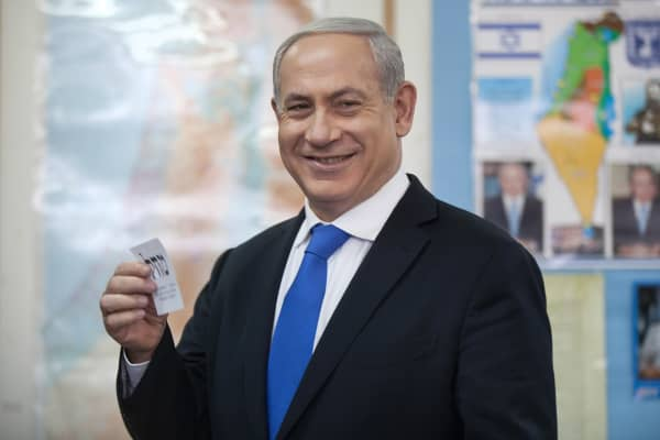 Israeli Prime Minister Benjamin Netanyahu casts his ballot at a polling station on election day, January 22, 2013 in Jerusalem, Israel.